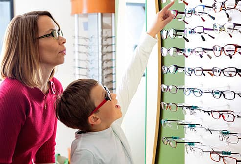 boy choosing glasses