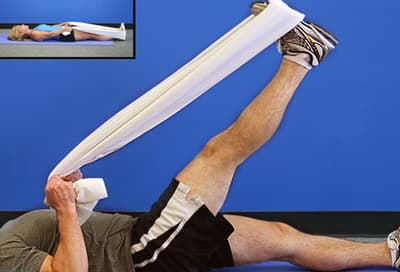Trainer doing a calf stretch with a chair