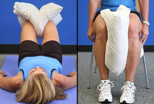 Trainer squeezing pillow between knees