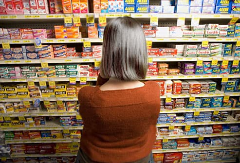 woman shopping for pain relievers