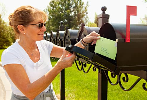 woman mailing letter