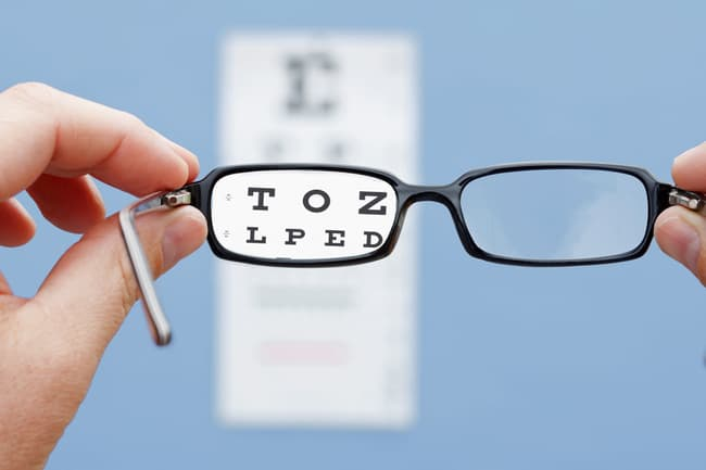photo of glasses and eye chart
