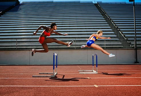 women doing hurtles