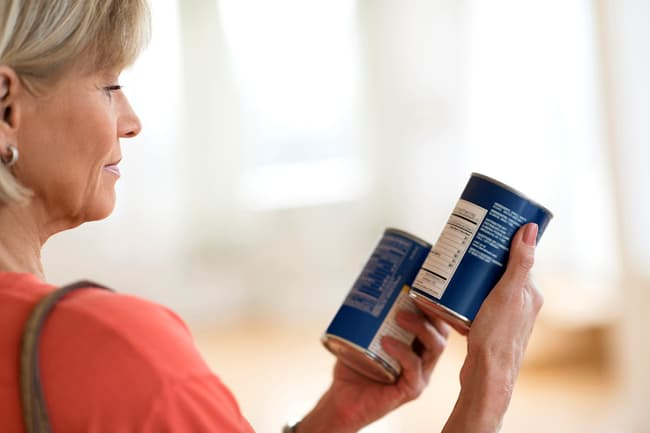 photo of woman reading labels
