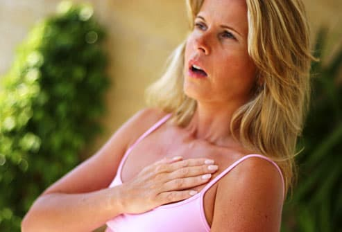 Woman experiencing chest pain