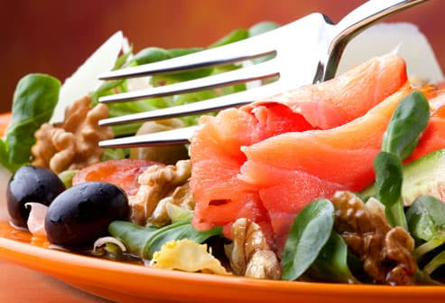 Salmon in salad with fork