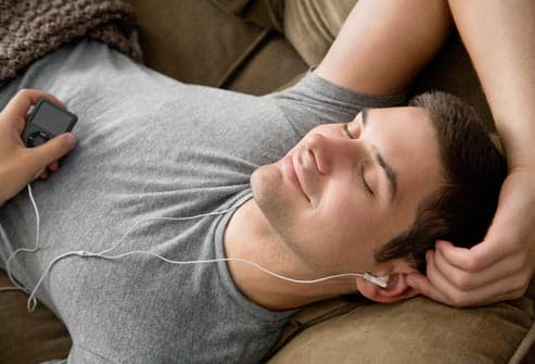 Smiling man listening to music