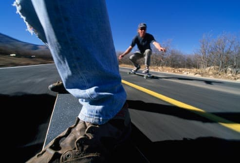 Men riding longboards