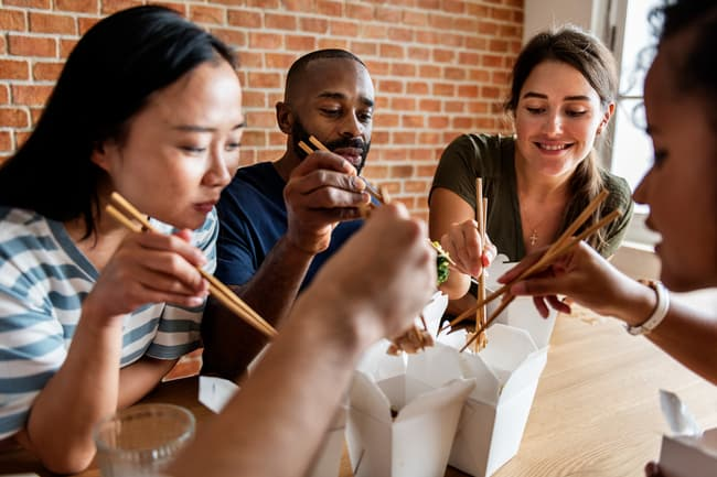photo of friends eating fast food