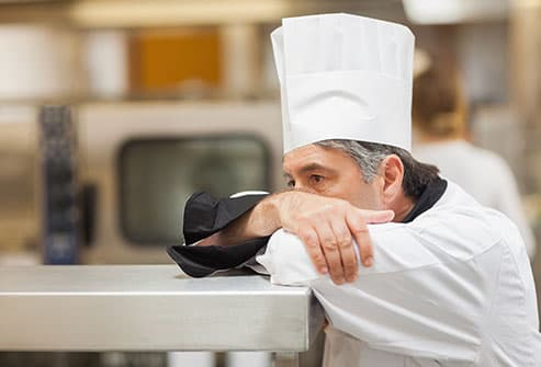 chef leaning on counter