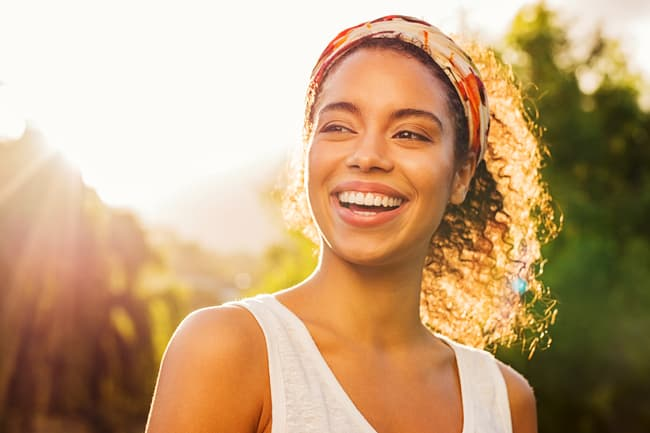 photo of person smiling in sunlight