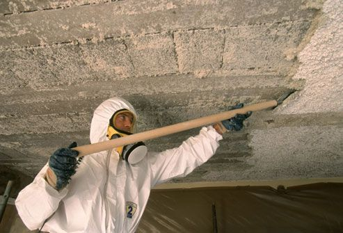 Man Removing Harmful Asbestos