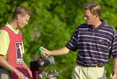 golfer sprays caddy with insect repellent