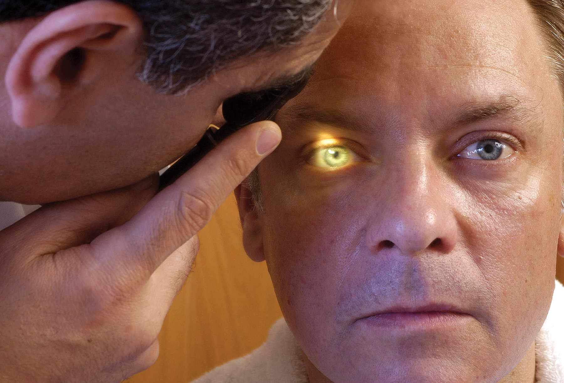 man getting opthalmology exam