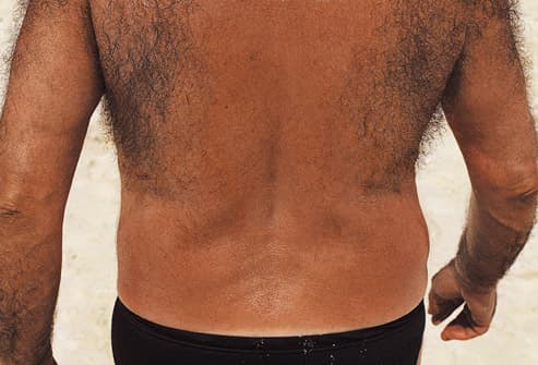 hairy backed man on beach