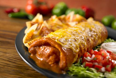 Burrito with cheese, sour cream and salsa