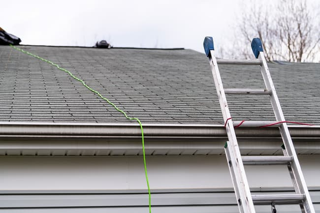 photo of ladder against roof