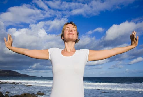 Woman Practicing Yoga to Relieve Stress