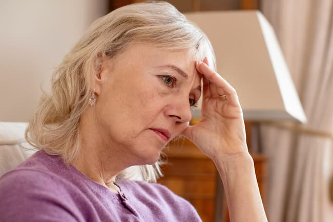 photo of anxious mature woman