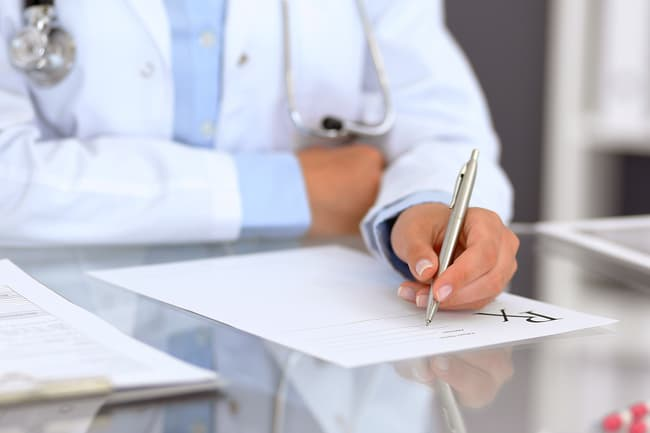 photo of doctor writing prescription