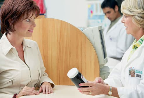 female pharmacist talking to woman