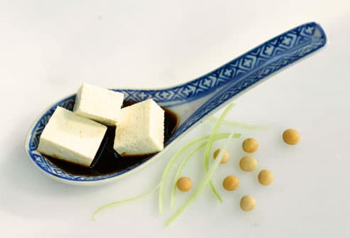 Tofu, soy sauce and soy beans, close-up