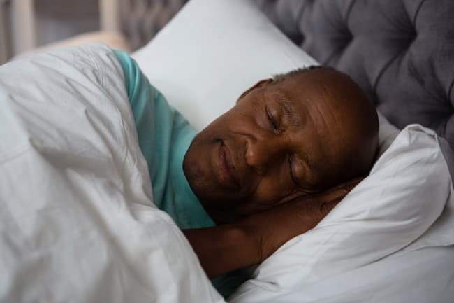photo of mature man sleeping