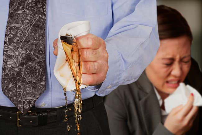 photo of person crushing coffee cup