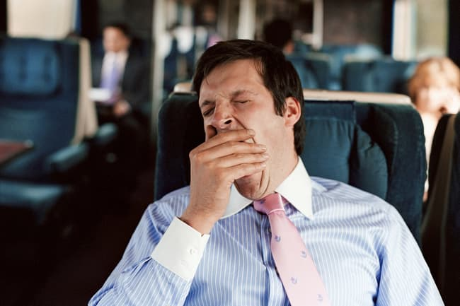 photo of man yawning on train