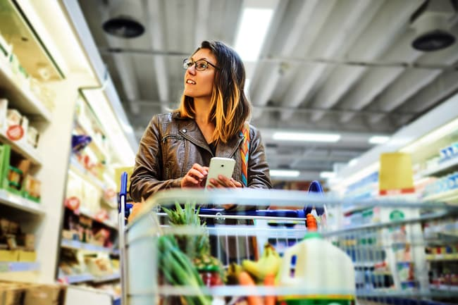 photo of woman using grocery app