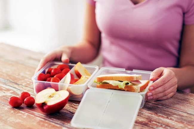 photo of woman packing healthy meal