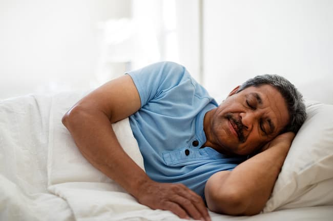 photo of mature man sleeping in bed