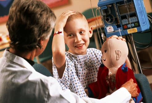 Juvenile cancer patient with doctor in hospital