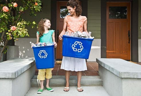 mom and daughter recycling