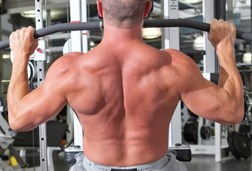 Flexed back muscles in wide-grip pulldown