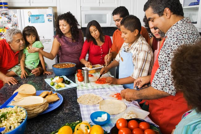 photo of large family preparing meal