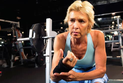 Woman feeling pain during exercise