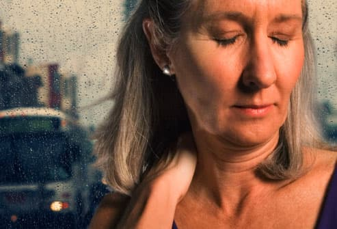 Woman with pain affected by weather