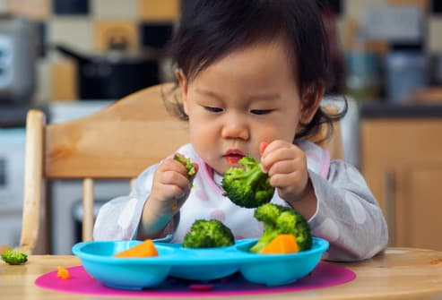 baby eating veggies