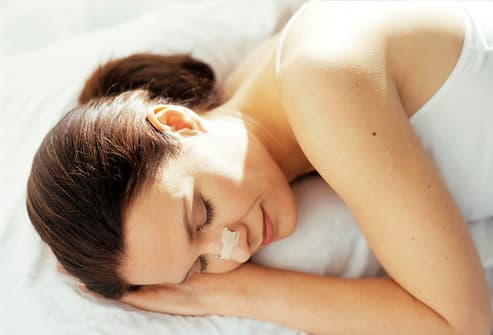 Sleeping Woman Wearing Nasal Strip