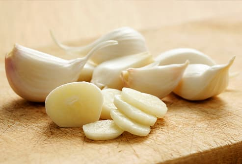 Cloves of garlic, partly sliced