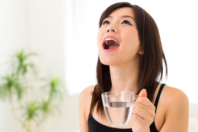 photo of person gargling salt water