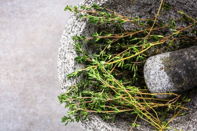 photo of ground thyme in mortar