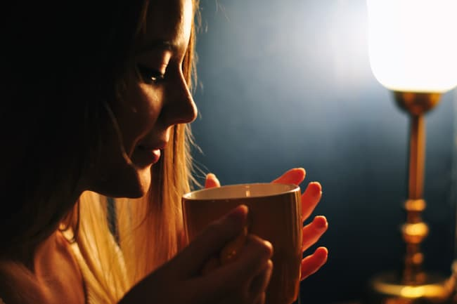 photo of woman drinking tea