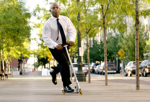 Business  Man on Razor Scooter