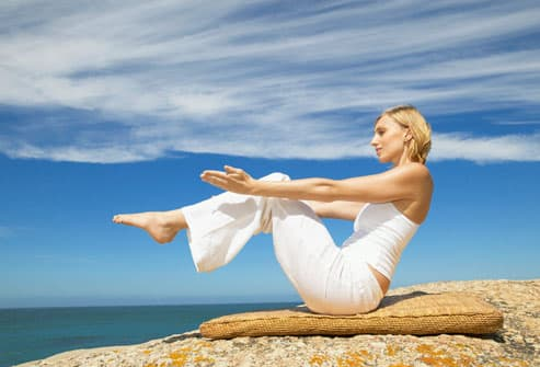 Woman on Rock Doing Yoga