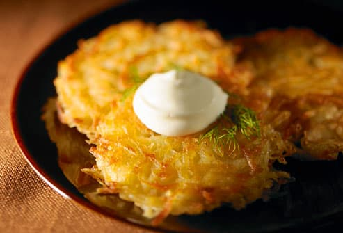 Three potato latke with sour cream