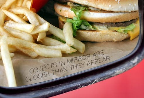 burger and fries in rearview mirror