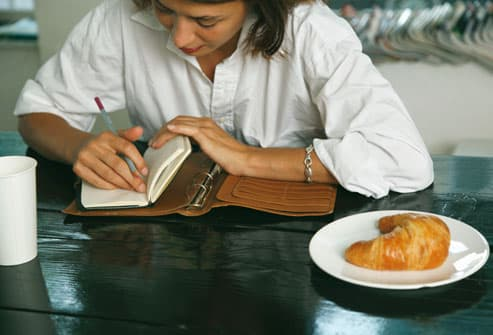 Woman Taking Notes in Food Diary