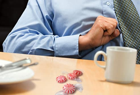 Man with Heartburn and Mints on Table